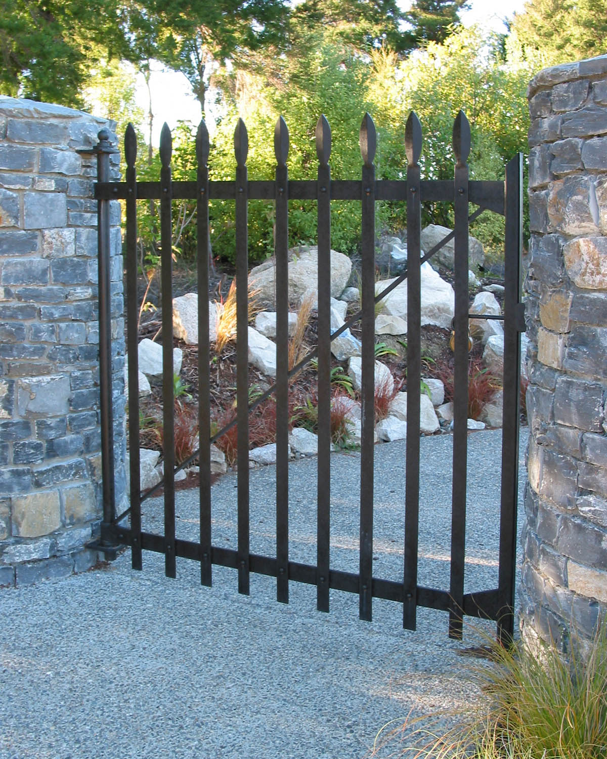 Riveted wrought iron driveway side gate